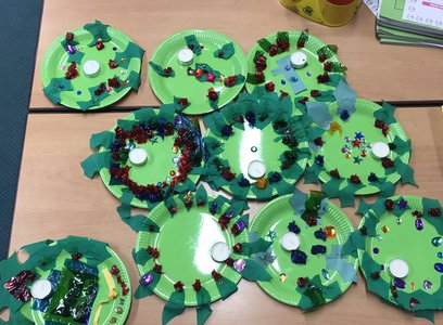 Decorated plates that school children have worked on in a classroom